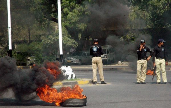 Angry protesters burn tyres during protest demonstration of traders community against electricity load-shedding at Gulberg area in Lahore on Friday, May 11, 2012.