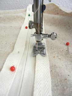 add a zipper ~~ to a bag.  Step-by-step instructions take out most of the fear of sewing a zipper onto something.