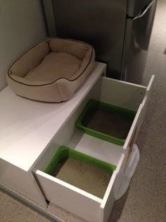 STUVA litterbox for 4 kitties - mine would probably prefer two separate chambers. STUVA does come in a single-width drawer, and you could get two. The trofasts have very low sides, though -- you'd want to use high-walled boxes so they didn't kick litter everywhere. Then you could put standard cabinetry on top. Love it!