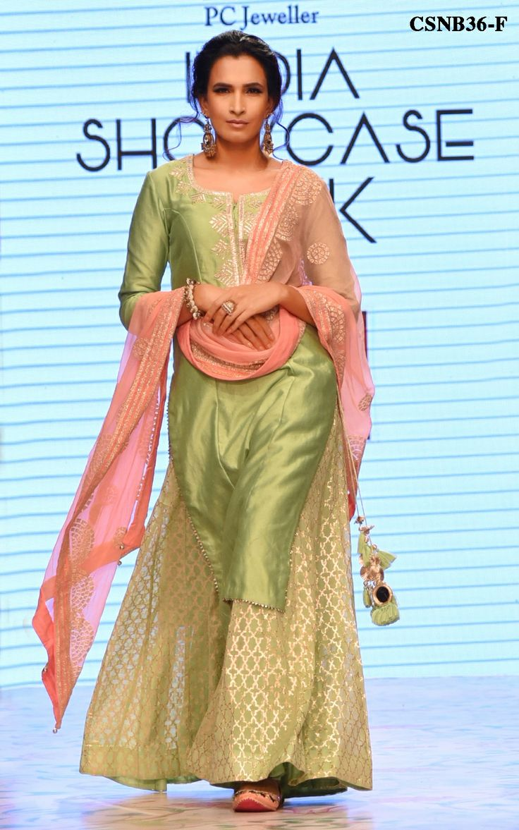 You cant go wrong with our beautifully detailed, minimal yet festive Pista green sharara set.The kurta is rendered in Chanderi fabric with gotta work on the neckline and tassels, this set is complete with a banarsi chanderi sharara and a contrast dupatta with graceful fine work on it. Color may slightly be different from the actual item due to photographic lighting sources or the monitors settings.