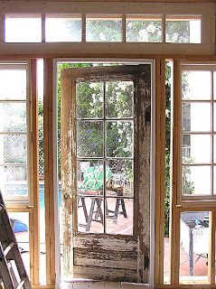 Salvaged Door and Windows - found at an antique shop and incorporated in a home addition - via Cute Pink Stuff: Windows, Doors and Progress!