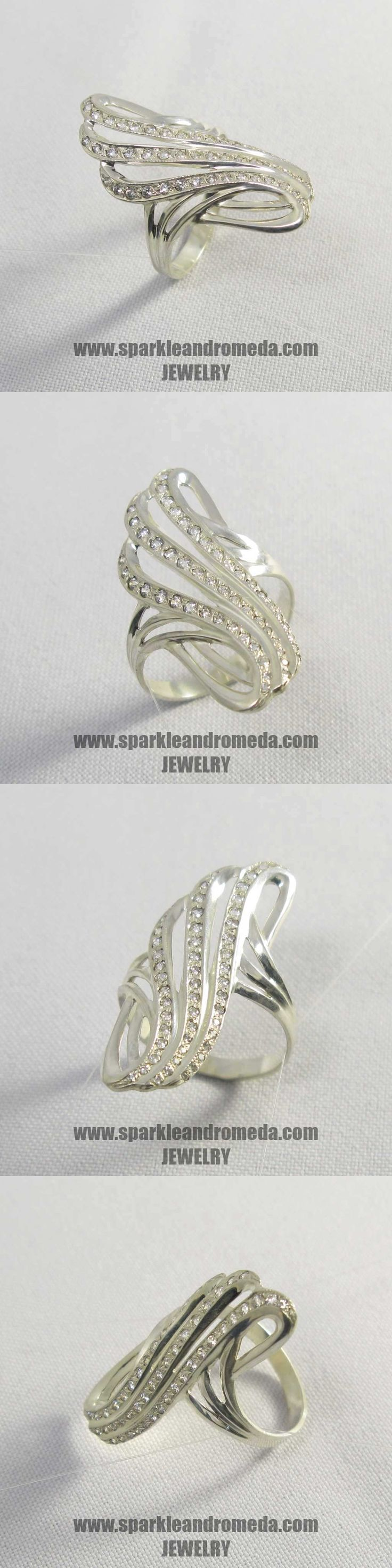 Sterling 925 silver ring with 18 round 1,5 mm 20 round 1,25 mm and 13 round 1 mm white color cubic zirconia gemstones.