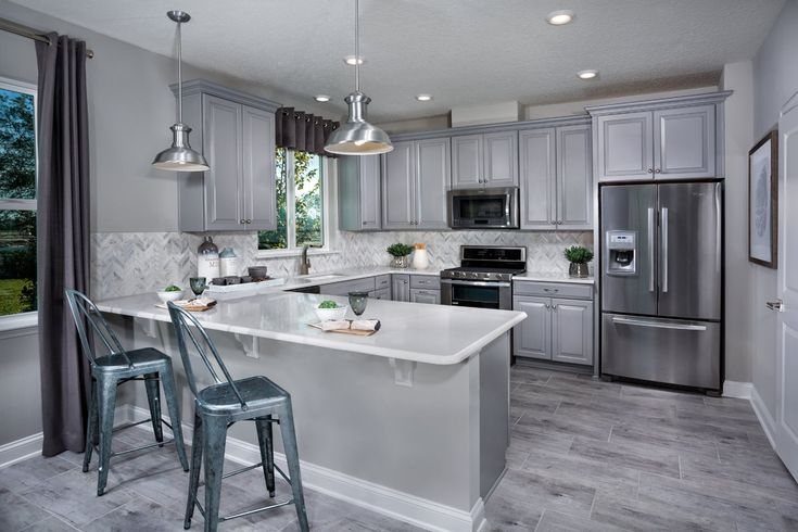 There's nothing gloomy about this sleek and modern grey kitchen. Southshore at Bannon Lakes- Classic Series. St. Augustine, Fl. KB Home Jacksonville.