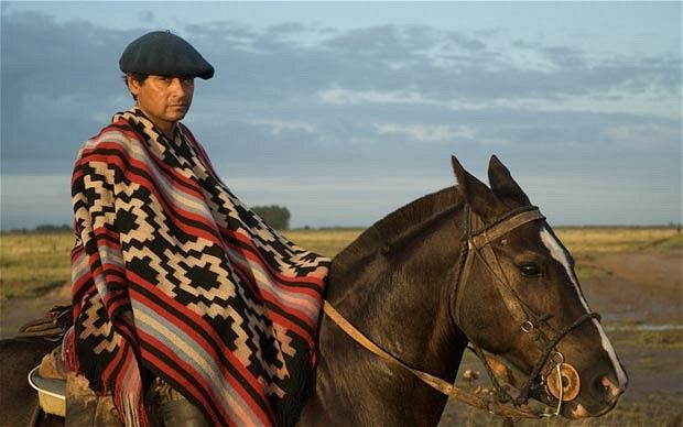 Horse-riding in Argentina: Welcome to the gaucho club. There is something about the Gaucho style making a Beret far more rural than you'd expect. Looks perfect.