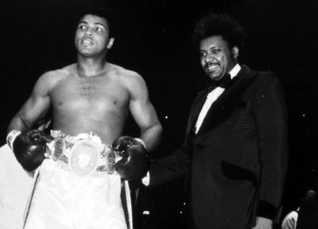 "The Greatest, Muhammad Ali, is presented with THE RING belt, just prior to defending his heavyweight championship against Chuck Wepner. Ali has earned his prize on the basis of an eighth round knockout over champion George Foreman, six months earlier, in ""The Rumble in the Jungle""."