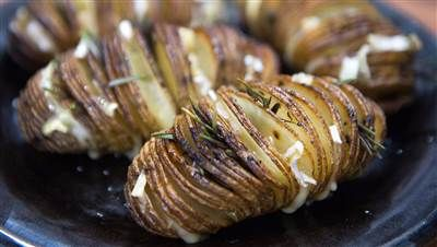 Step up your potato game with cheesy, garlicy, Hasselback spuds