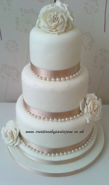 With alternating pink & grey ribbon with a bow, obviously