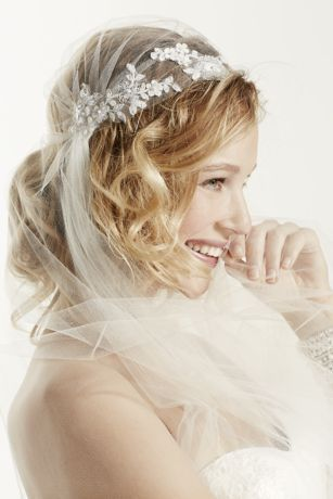 "This ethereal inspired Juliet Cap cathedral veil is easy to wear and the perfect final touch for a vintage or rustic spirited wedding!  Cathedral length veil features eye-catching and beautifully designed Juliet cap detail.  Single tier measures 90"" in length.  Available in Ivory.  Imported. *Note: This veil does not come with a comb."