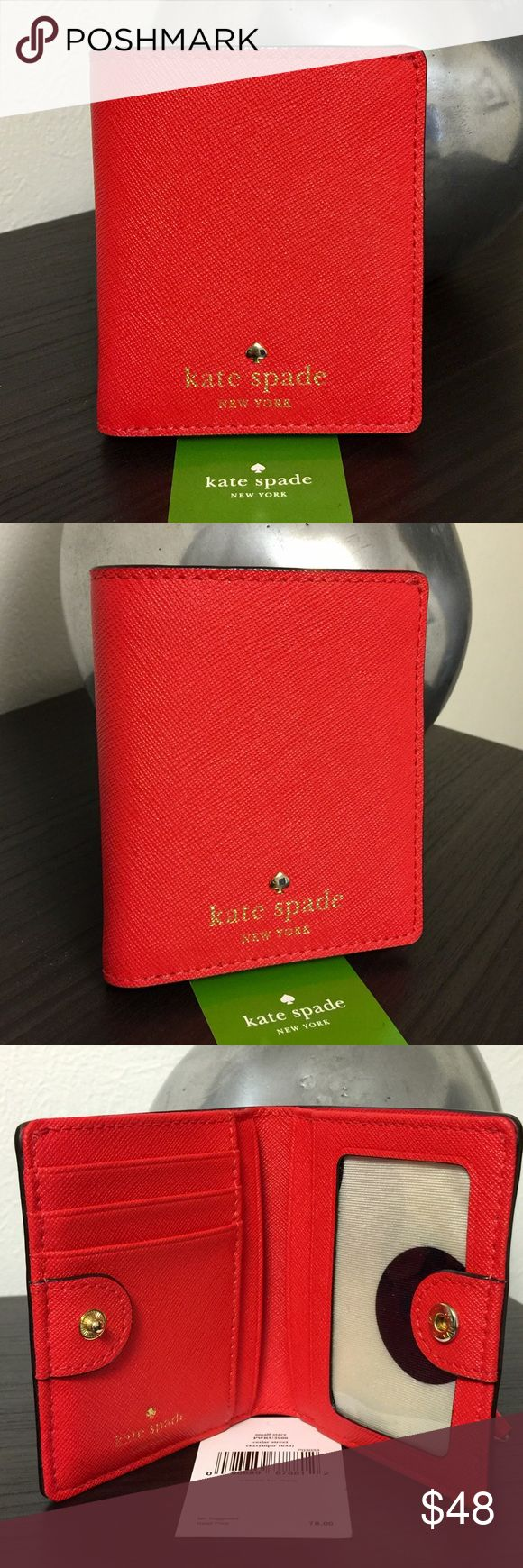 "Kate Spade New York Small Wallet Kate Spade small wallet in red crosshatched leather with snap closure. 1 billfold, 1 id slot, 6 credit card slots, exterior zip pocket. Embossed light gold spade logo stud & printed logo. Preowned but in excellent condition with the exception of the printed logo inside which is faded a bit. Only used couple times for traveling. I still have the original price tag with MSRP $78. Wallet measures approximately 3.75""H x 3.25""W. From smoke free pet free home. 10%…"
