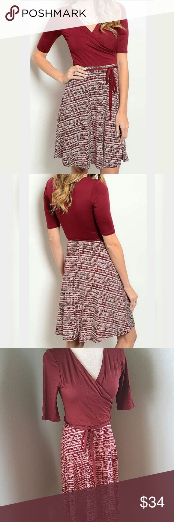 "Burgundy patterned wrap look dress Ultra flattering. Ties at waist. Viscose spandex top. Polyester spandex bottom. Dress is medium but fits like a small so I am marking it small. Half sleeves. 35"" length. Dresses"