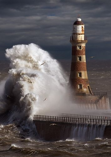 The strength of the sea against the strength of the lighthouse.