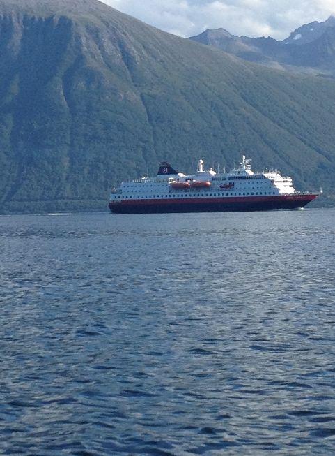 Hurtigruta on a daily visit in Ålesund #Hurtigruta #Hurtigruten #boat #mountain #water #sea #view #sky #ship