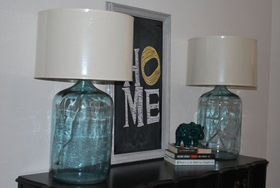 Custom Vintage 5 gallon glass water jug repurposed as a more contemporary lamp with pottery barn drum shades.