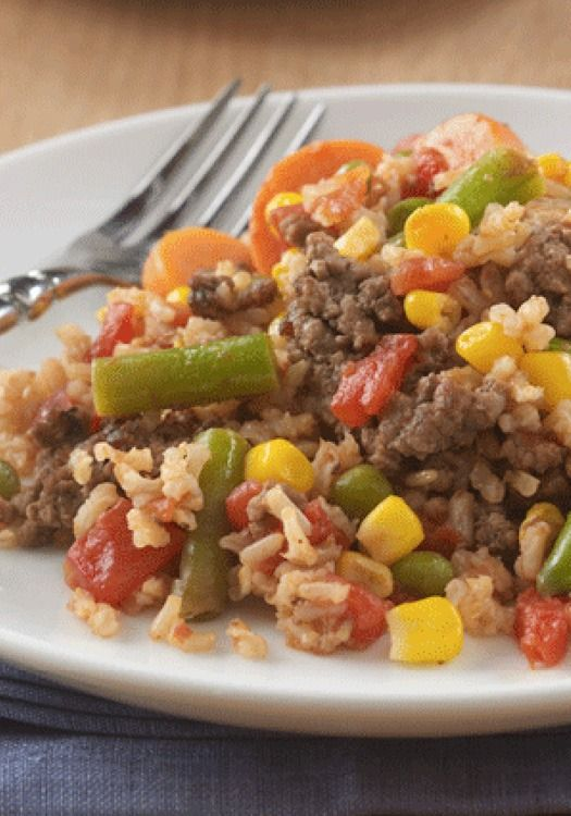 Beefy Rice Skillet -- Make this delicious one-skillet recipe with lean ground beef, brown rice, vegetables, and juicy tomatoes for an easy dinner option.