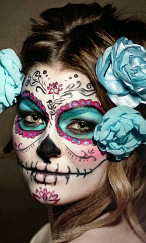Blue, pink, and black sugar skull design.