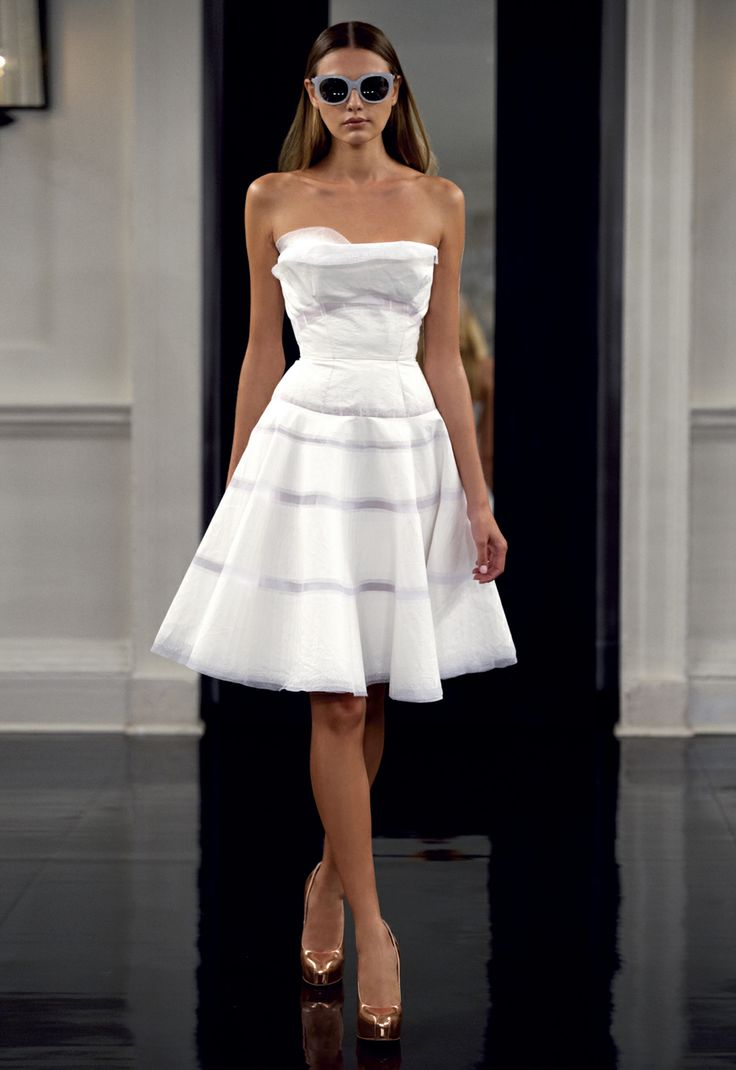 I Love this! It mixes two of my favorites: Victoria Beckham design mixed with Charlotte York's look...Sexy/Elegant