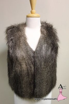 Ann Taylor faux fur vest, size SMALL Polyester and acrylic, lined in polyester Varying shades of brown $25.00