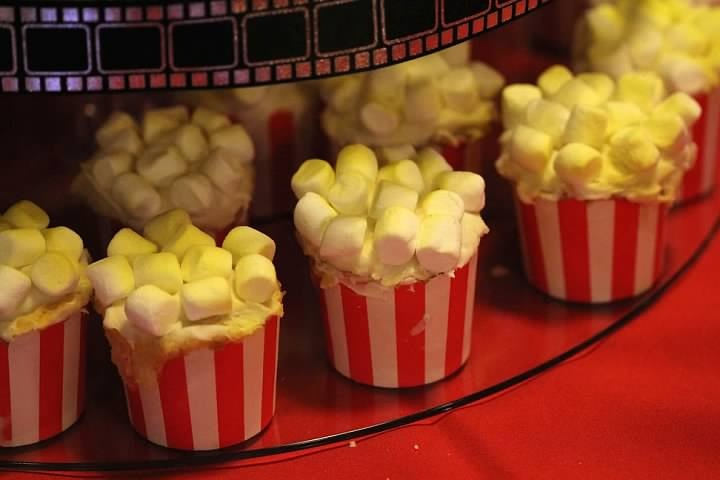 """""""Popcorn"""" cupcakes to tie in with the movie theater theme!"""