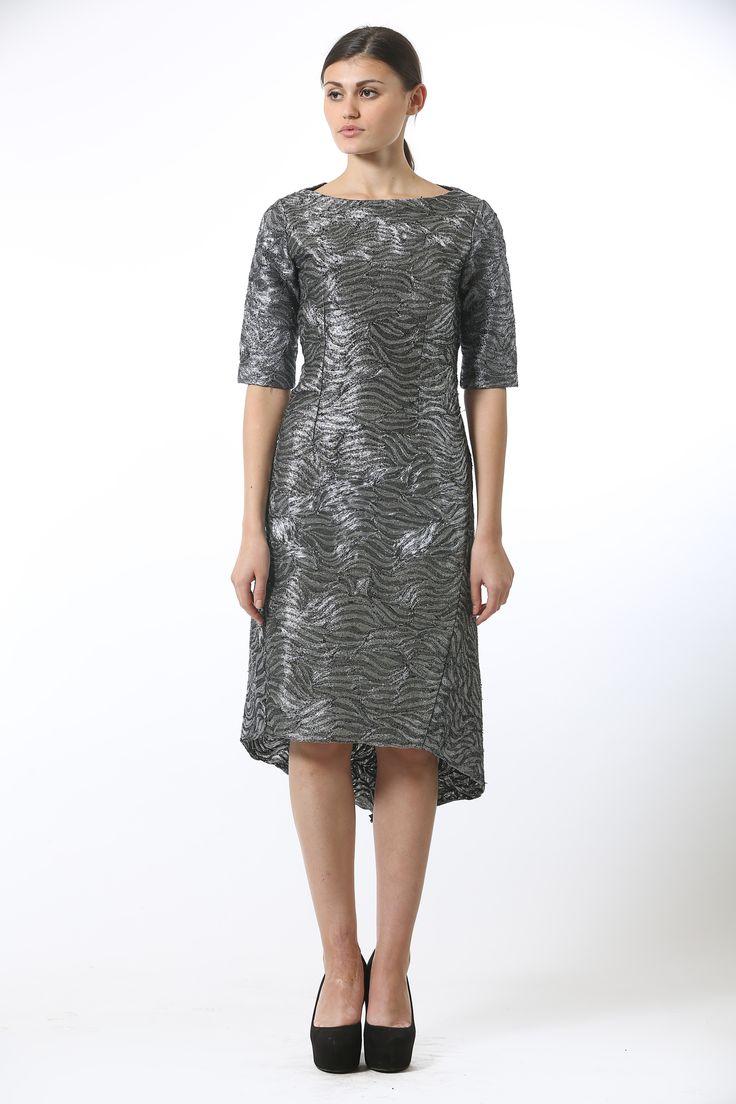Silver metallic embroidered silk organza midi length dress featuring an asymmetrical hemline and an off center conceal zip bone detail.