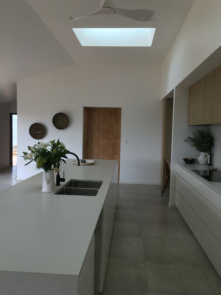 This kitchen in the Australian outback .... Fresh concrete Caesarstone 4 m long bench