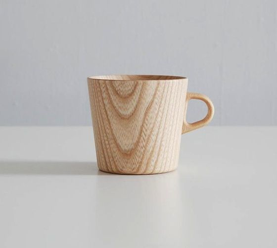 "Futagami Kami Mug Cup – $60 . Wooden mug cups perfect for coffee or tea. Keeps the drink hot as the wood works as a natural insulator. Wooden cups made of Castor Aralia grown in Hokkaido. Shaped by hand using a wheel, it is only a couple of millimeter-thick. ""Kami"" means ""paper"" in Japanese, and it is named after its sheer texture. It gives a smooth, warm touch on your lips."