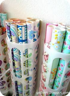 Trash bag holders from Ikea for wrapping paper or rolls of material. For my sewing/craft room