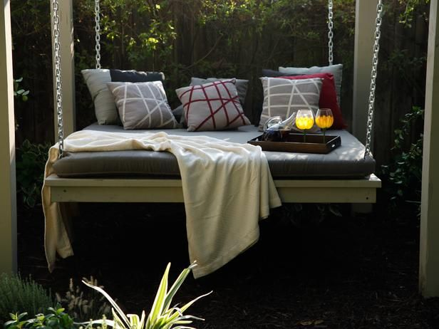 This shady backyard provided a perfect spot for a hanging daybed for lazy lounging, as seen on The Outdoor Room by Jamie Durie on HGTV. The mattress is covered with heavy-duty outdoor fabric to help it withstand the elements.