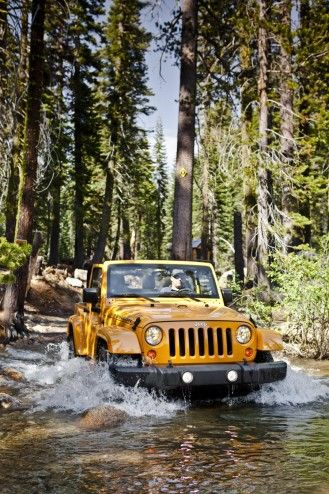 ♂ Yellow jeep Wrangler Rubicon in the nature forest water