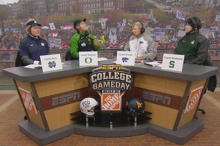 ESPN's  College  GameDay   crew brought back one of their oddest, slightly terrifying traditions during Week 10 of the 2014 college football season, as they all donned masks of prominent coaches...