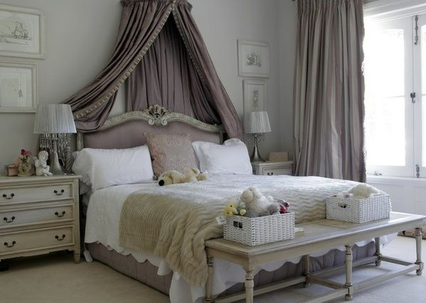 Love the canopy over the bed and draped back behind the headboard
