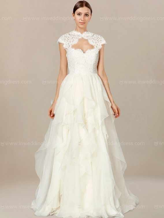 Informal wedding dress is an enchanting style with Lace cap sleeves forming keyhole in front and back.