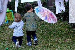 Eti taking Mattie for a stroll under his home made parasol
