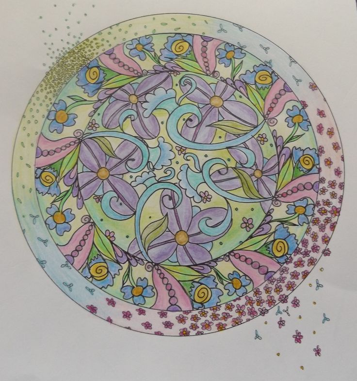 Another pretty mandala from The Artful Mandala coloured by Patricia with coloured pencils
