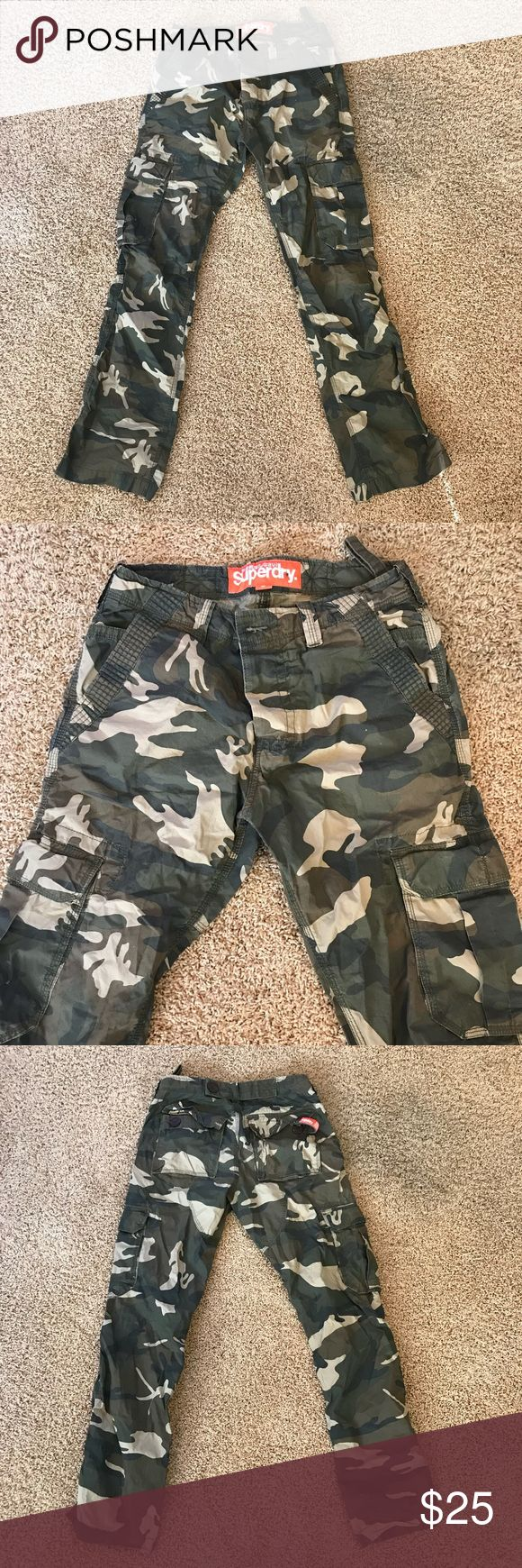 Men's Superdry Camouflage Camo Cargo Pants S Small Up for sale is a pair of Men's Superdry Camo pants in a size small. These pants are in very good condition and offer plenty of pockets for storage. Additionally, it has a 3 button fly as well as buttoned pockets on the back. Please feel free to message me with any questions, thanks for looking! :) Superdry Pants Cargo
