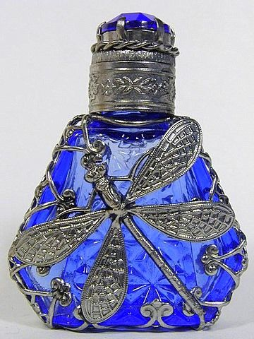 Perfume Bottle beautiful blue glass and dragonfly motif.