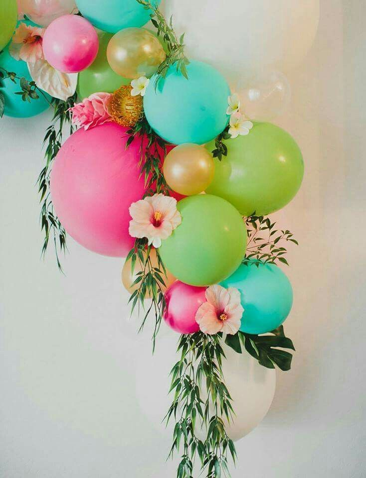 Such a beautiful way to incorporate bright colored balloons, flowers and greenery.  Would be awesome decor at a Hawaiian Luau themed Baby Shower