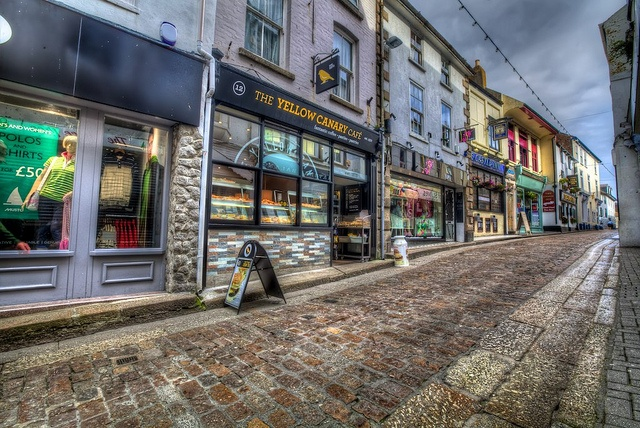 Fore Street Shops St Ives    Cobbled street and shops in St Ives Cornwall    Early morning.