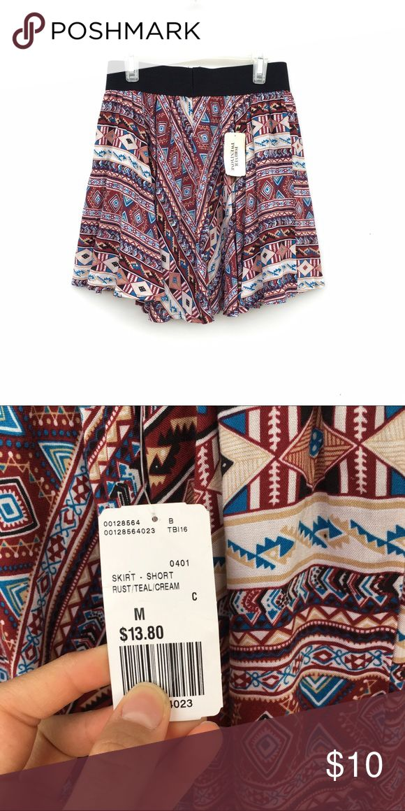 NWT Tribal Print Skirt New without tags and never worn tribal printed multi-colored skirt. Waistband is stretchy, and skirt is flowy. Skirts Circle & Skater