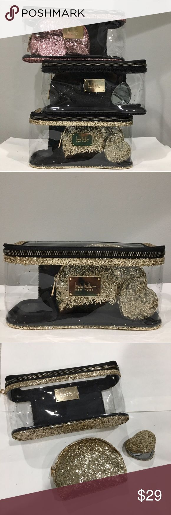 """NICOLE MILLER GOLD GLITTER 3 Pc set cosmetic bag PRICE FIRM Nicole Miller GOLD Glitter 3 Pc Clear Cosmetic Make Up Cases Bags with Heart Mirror Super cute sparkly 3 piece glitter cosmetic case gift set. Each set comes w large clear case that measures approximately 9"""" x 4""""x 4 1/4"""", a smaller glitter case and a small glitter covered heart shaped mirror. This set is a great gift for teachers, friends, or birthday presents. *Please note some glitter may come loose and add some sparkle where it…"""
