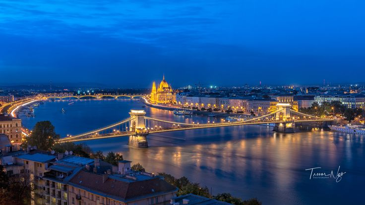 Crossing - The Chain Bridge is one of the best known landmarks of Budapest. The picturesque historic stone bridge straddles the Danube between Széchenyi Square on the Pest side and Clark Ádám Square in Buda. The grandiose Parliament dominates the riverside in Pest, while Castle Hill towers at the Buda end.