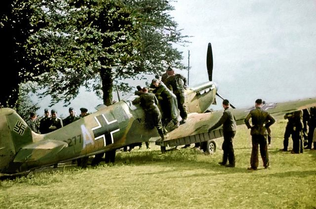 Captured Spitfire 1940. On the 15th August 1940 Pilot Officer Richard Hardy's Spitfire mk.1a was damaged in combat and he was forced to land near Cherbourg where it fell into German hands.This image shows the aircraft just after German markings were applied.