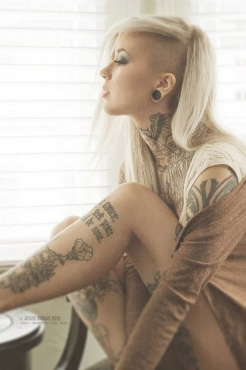 If I only had the courage...the tatts, the giant guages (already got the side shave)...this would be ME...in a heartbeat.