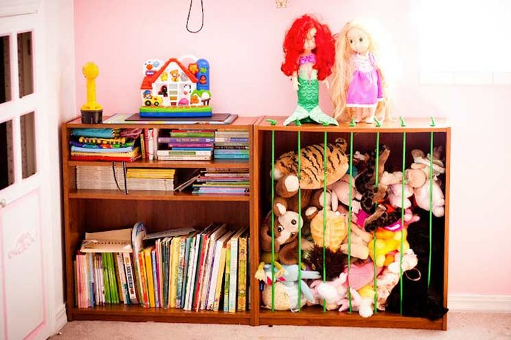 Toy storage ideas: Make a zoo for the kids' plush toys using an old bookshelf and some bungee cords.