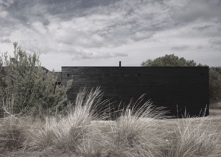 Melbourne, Australia... This rural residence outside Melbourne by architects Studio Four features a blackened timber exterior and terraces that step down a hill