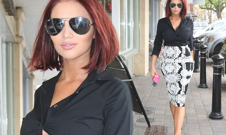 Amy Childs inadvertently flashes her chest in a gaping shirt #DailyMail