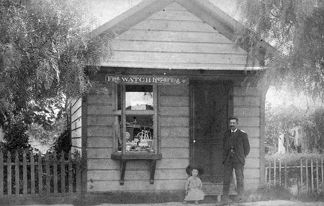 1885-Fine Watch Repairing. A business in vintage Long Beach, California. Looks like his house and  well as his business