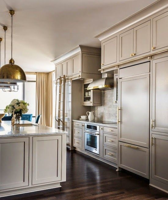 taupe/greige cabinets with brass hardware