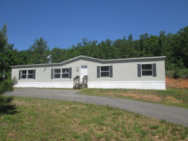 """185 Grand Trunk Rd, Conway AR 72032. located off the corner of Clinton Road and Grand Trunk Road by Lake Conway feature one story mobile home with a split floor plan. Master suite with its private bath and three bedrooms/two bath on the opposite side of the home. HUD Case #031-344670 sold """"AS IS"""" log on www.hudhomestore.com to submit offers and www.mmrem.com for management information."""