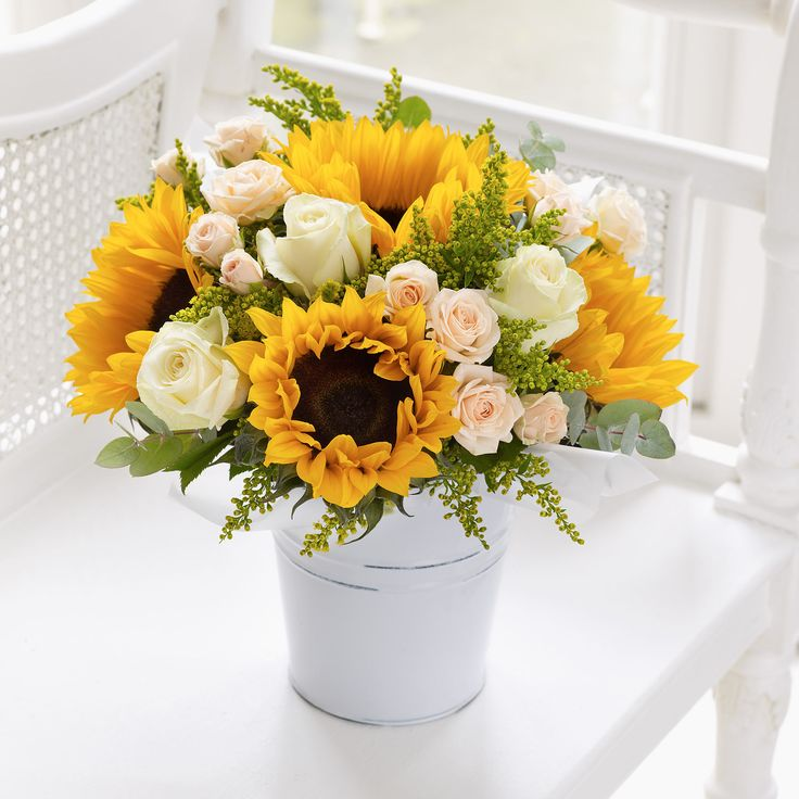 22 best yellow wedding flowers images on pinterest yellow wedding fairtrade sunflower and rose pail interflora featuring 4 yellow sunflowers 3 peach spray roses and 3 cream roses with solidago and eucalyptus mightylinksfo