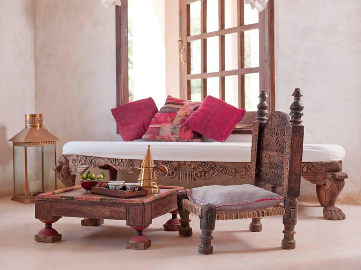 These are Hand-carved wooden furniture found at the The Majlis in Lamu, Kenya, But it could so easily be Indian.